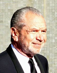 "Alan Michael Sugar, Baron Sugar, Kt (born 1947) is a business magnate, media personality, and political adviser. According to the Sunday Times Rich List, Sugar joined the ""billionaire's club"" in 2015 and in 2016 they estimated his fortune at £1.15bn, and ranked him as the 95th richest person in the UK. In 2007, he sold his remaining interest in the consumer electronics company Amstrad, his largest and best-known business venture."