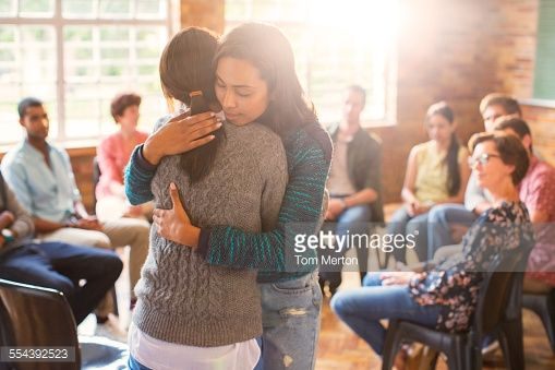Stock Photo : Women hugging in group therapy session