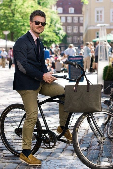 street style: Man on bike in Jacket with elbow patch and khaki pants