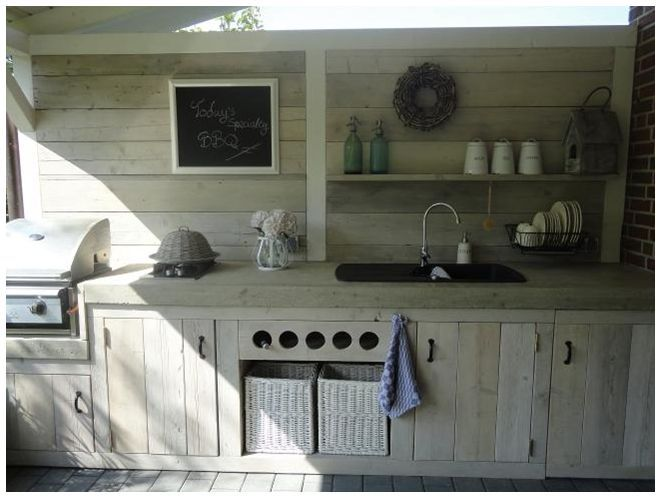 An outdoor kitchen, cabinets made with recycled pallet wood. Would be nice indoors too!