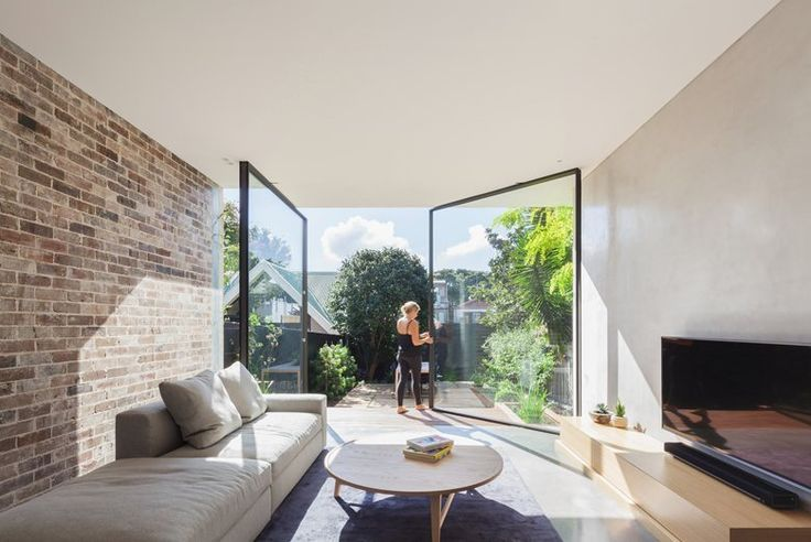 Set within a heritage conservation area, the original semi has been kept in-tact with its roof line restored. A 'breezeway' transition space connects the original house and its new split level contemporary addition, allowing light to filter in to what was otherwise a typical, dark and gloomy south facing house #livingroom
