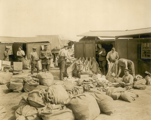 Mail being sorted at a Field Post Office, First World War. (POST 56/6)
