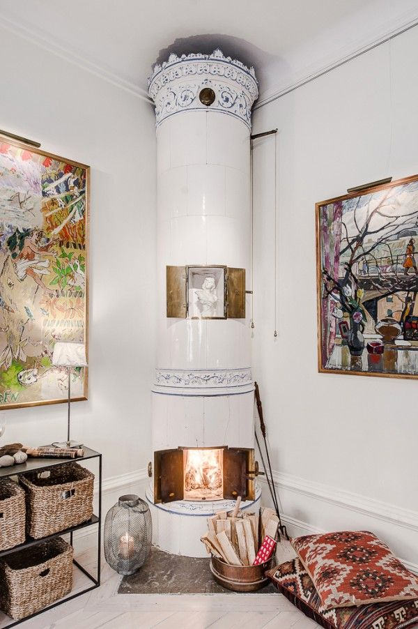 Over in one corner, a ceramic wood burning stove, of an antique Scandinavian design...