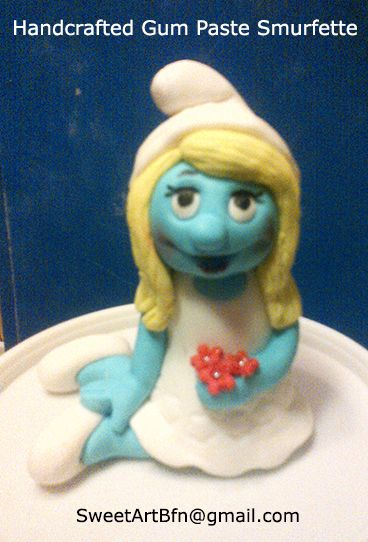 Handcrafted gum paste Smurfette Cake topper For more information & orders, Email: sweetartbfn@gmail.com; Call 0712127786,; Follow me on Facebook: https://www.facebook.com/groups/SweetArtCakesBloemfontein/ & Pinterest: http://www.pinterest.com/SweetArtCakeBfn/bloemfontein-cakes/