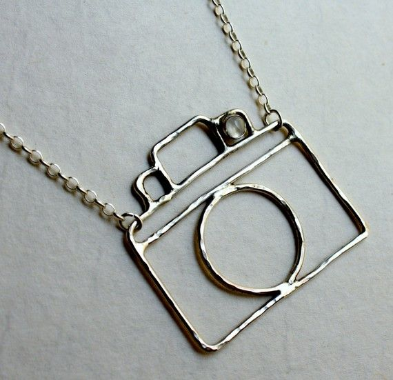 """adorable tiny camera necklace, complete with a little moonstone """"flash."""""""