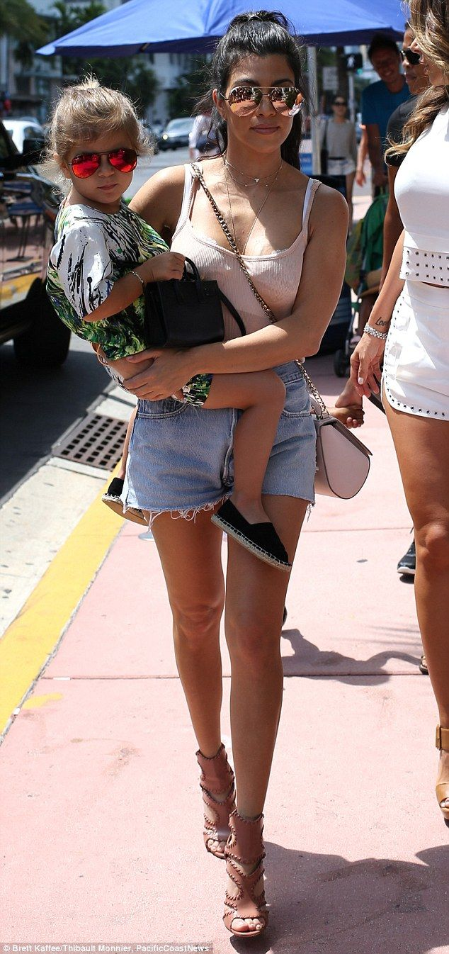 Dressed for sunshine: Kourtney was casually low-key in a tank top and frayed Daisy Dukes with chunky sandal heels. Penelope had on a colorful short-sleeved dress and both mom and daughter rocked Aviator shades