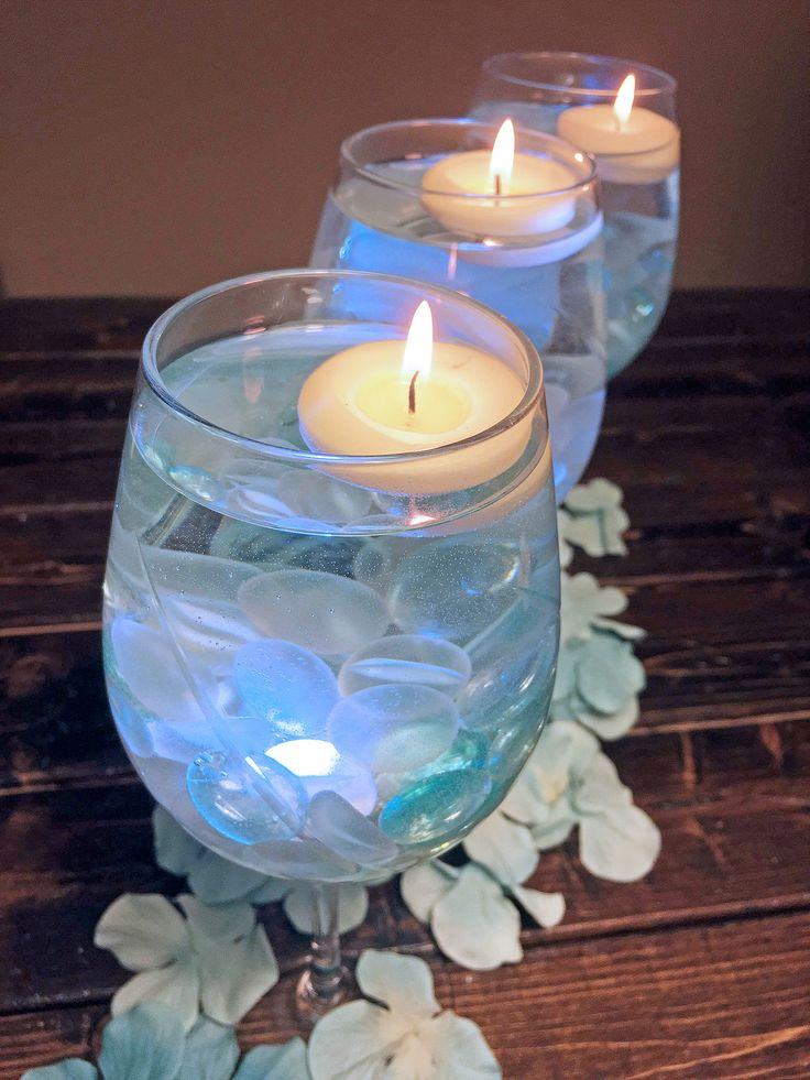 How to make a simple wine glass centerpiece great for for Centerpieces made with wine glasses