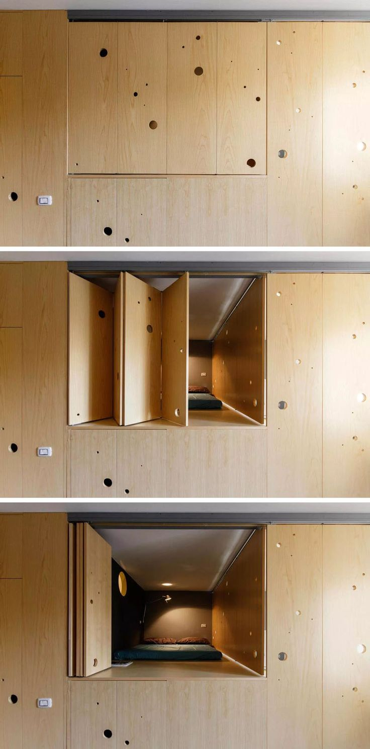 This wooden wall opens up to reveal a lofted bed in this tiny apartment.