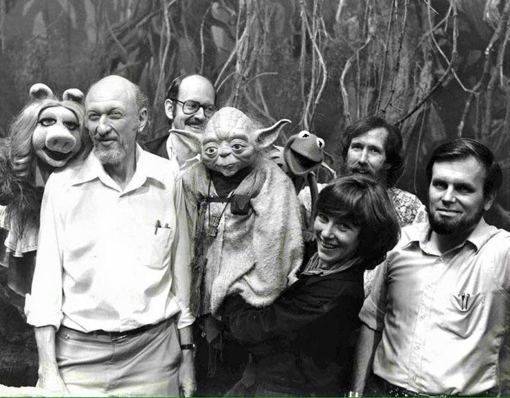 Irvin Kershner, Frank Oz, Kathryn Mullen, Jim Henson and Gary Kurtz with Miss Piggy, Yoda and Kermit on the set of The Empire Strikes Back.