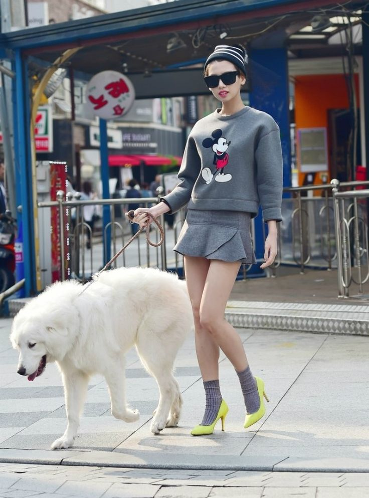 Adorable Mickey Mouse sweater with girlish layered skirt. Specially love her neon yellow high heels pointed in gray tone outfit.