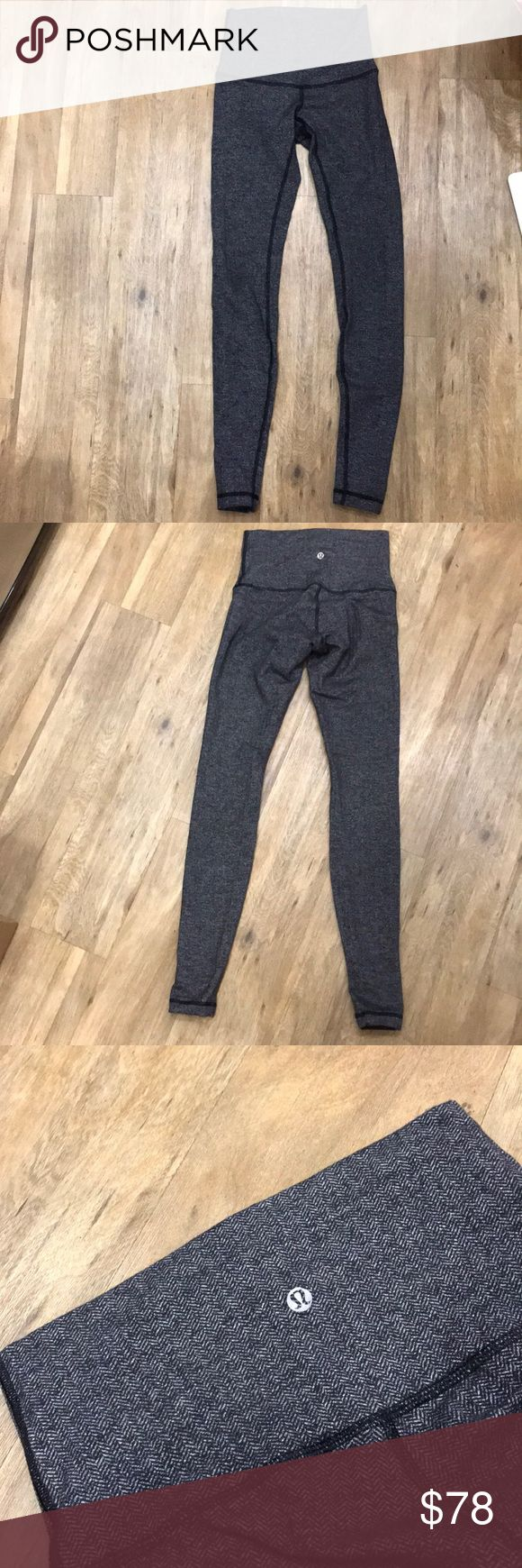 Lululemon Herringbone Wunder Under Pant Amazingly soft, herringbone, grey/black Lululemon Wunder Under pants. Size 4. Come to ankle or longer. High-waisted with reflective Lululemon logo on the back waistband - centered. Like new, amazing condition and well-cared for. Perfect for cold weather or school! lululemon athletica Pants Leggings