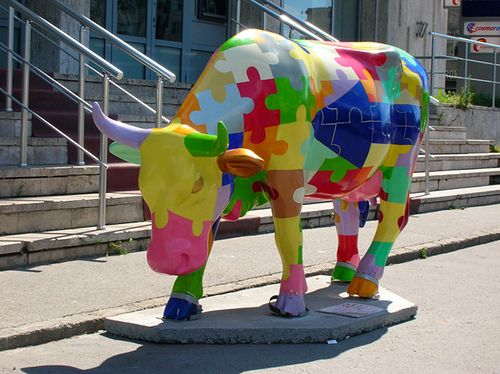 "Bucharest, Romania - Cows on Parade 2005 - ""Vaca Puzzle"" - 100 life size fiberglass cow statues"