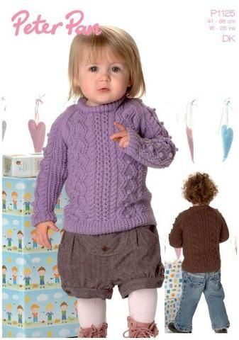 Wendy Peter Pan P1125 Bobble and Cable Sweater uses Peter Pan DK yarn (#2) weight. Sizes newborn to 7 years.