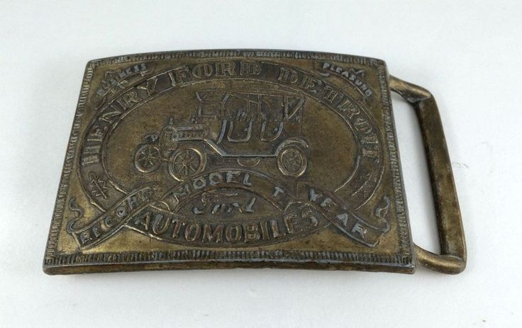 Collectible or wearable Vintage Ford Model T Belt Buckle.  - 2020340010 on the back of the belt.  - Metal material.  - 3 1/8 inches wide.
