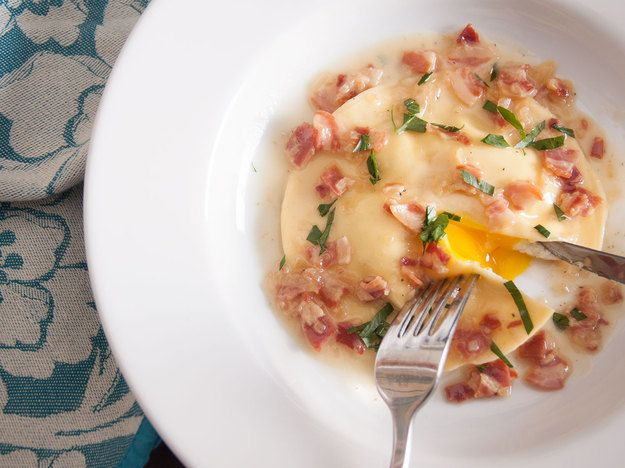 Picture this: gorgeous oversized ravioli filled with a ring of creamy ricotta surrounding a perfectly intact, perfectly runny yolk. They're rich, delicious, and freaking beautiful.