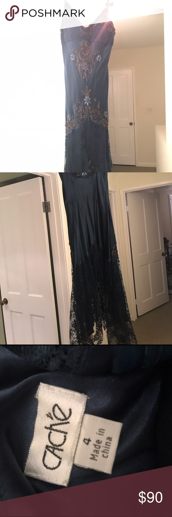 Midnight blue silk cocktail dress w gold beading Adjustable straps, lower cut with built in bra. Form fitting on bodice with a flowy lace trim on the bottom. Falls below the knee. Gold beaded designs along the silk fabric. Cache Dresses