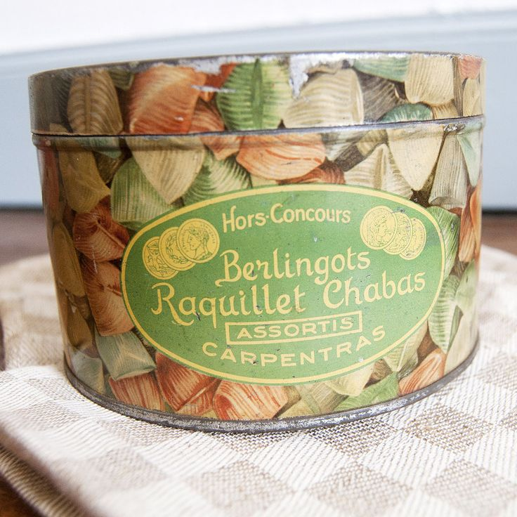 Vintage candy box in iron 50s. This french storage box used to contain hard candy Raquillet & Chabas Carpentras. #antique #vintage #french #container Antique tin box in metal. This small storage box is round. So colorful!