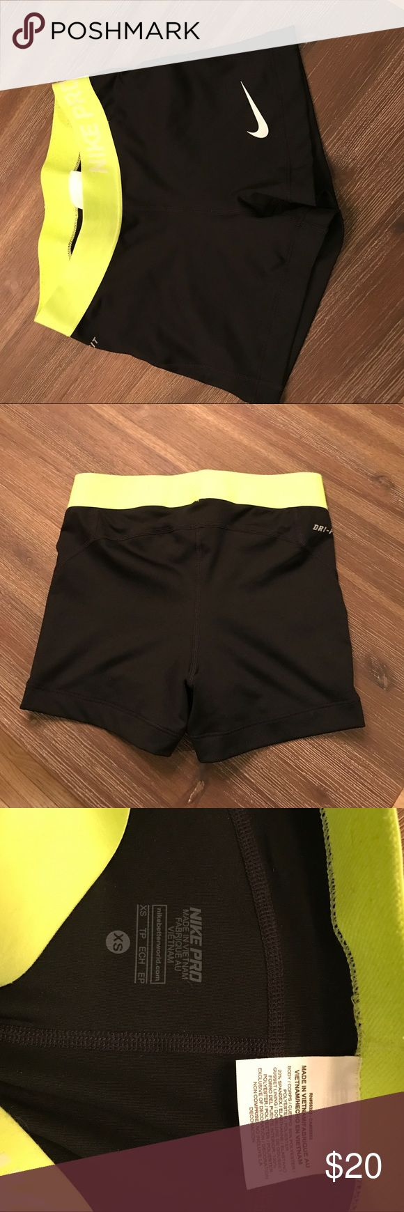 Nike black spandex shorts with lime green waist In great condition wore once Nike Pro black spandex shorts with lime green waist band perfect for yoga or running extremely comfortable Nike Shorts