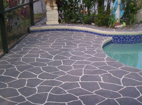 PIN 4: The dark grey colour concrete makes the blue swimming pool and dark blue design on the sides stand out. The white design on the concrete is also very creative and interesting; giving it more emphasis.