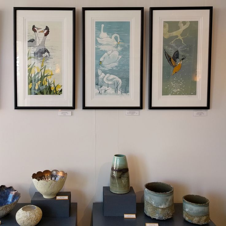Soft woodcuts by #lauraboswell contrasting beautifully with the texture of #paulwearing vessels . #acrossthewater ends on 23 September . #artgallery #ticehurst #eastsussex #painting #ceramics #janebridger #hollybell #birdsinart #swans #kingfisher #grebes #cylinder #seaurchin