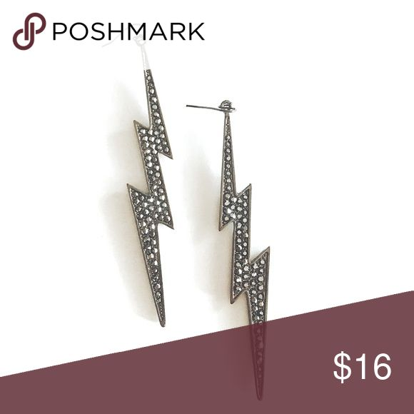 Rockstar Drop Earrings Make a statement with these unique earrings. Take these beauties to your next rock concert and get ready for a conversation starter. Earrings measure 10 cm in length. All pictures are mine unless otherwise stated. 📸 Happy to answer any questions prior to purchase. 😊 LS & Co. Jewelry Earrings