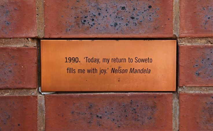 """""""That night I returned with Winnie to No. 8115 in Orlando West. It was only then that I knew in my heart I had left prison. For me No. 8115 was the centre point of my world, the place marked with an X in my mental geography."""" Nelson Mandela, The Long Walk to Freedom. Tile in the wall of Mandela house, Soweto, Johannesburg, South Africa. © Miikka Järvinen 2013"""