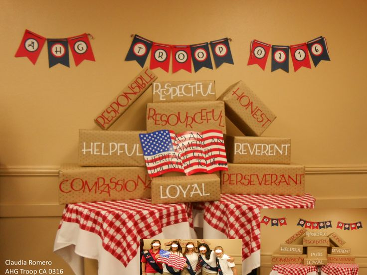 AHG Ceremonies:This was our 2013 picture booth back drop we did to take pictures at our award/crossover ceremony. We used our AHG creed. We wrap the boxes with printed star Kraft wrapping paper. The girls hold a flag sign that said As an American Heritage Girl I promise to be.....