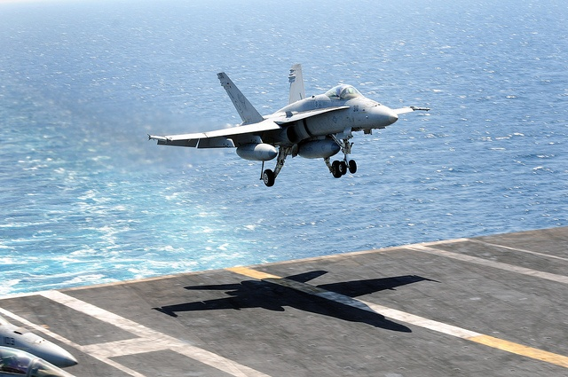 F/A-18C Hornet lands aboard ship. by Official U.S. Navy Imagery, via Flickr