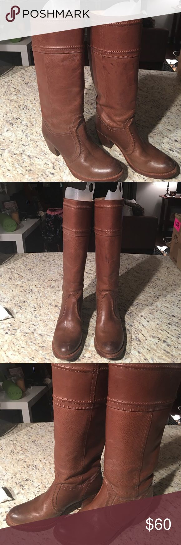 Frye Tall Boots in Light Brown Color Sz: 8 I'm doing a major closet clean out!   DETAILS - These are such cute Fyre boots. I've worn them a few times and then started a job that was business casual. They are perfect for spring and fall!   MATERIALS - Leather  WEAR - There is a little wear around one of the heels but other than that they are almost new.   **My items are priced to sell. These photos DO NOT have a filter, they are original!** Frye Shoes Heeled Boots