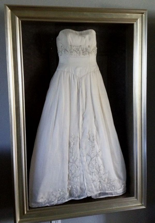 Framed wedding dress by Floral Keepsakes  in one of or custom shadow boxes http://www.facebook.com/FloralKeepsakesBoutique