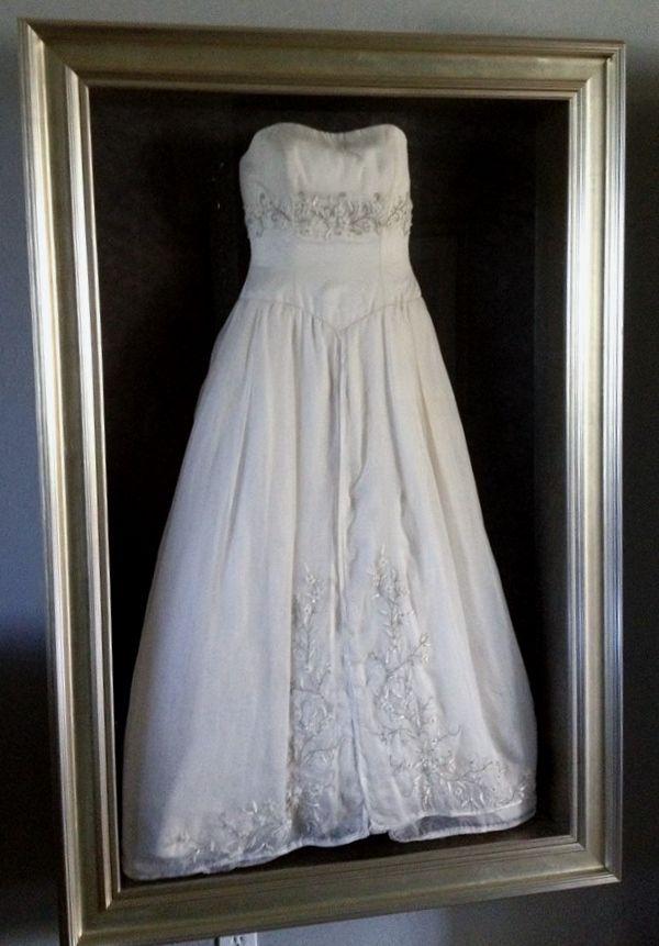 Framed wedding dress by Floral Keepsakes  in one of or custom shadow boxes http://www.facebook.com/FloralKeepsakesBoutique