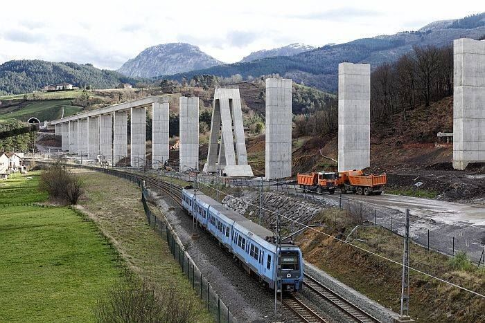 Commuter on the left and the construction of a viaduct for a HSR on the right. Durango (Spain).