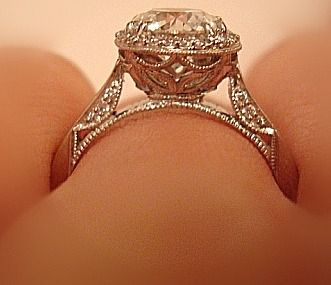 Whatever way you look at it, this Tacori Ring is spectacular! Almost looks like you could flip up the diamond and store coke...*sniff*