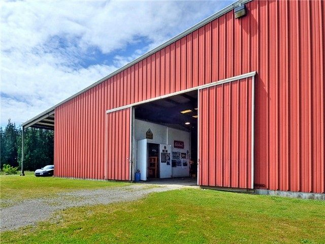 Steel framed equestrian arena is fully operational. Over 30,000 sq ft indoor arena. 100x300 area. Special flooring, Stables, and much more. Was used for a very successful equestrian business. Currently being used as a Mechanic's Dream Shop .. can be converted easily . Bring your own hobbies and ideas.