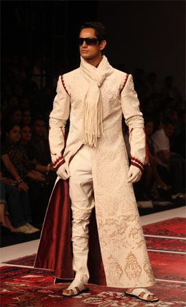 A model presents JJ Valaya's outfits during the Van Heusen India Men's Week in New Delhi. Express Photo by Renuka Puri