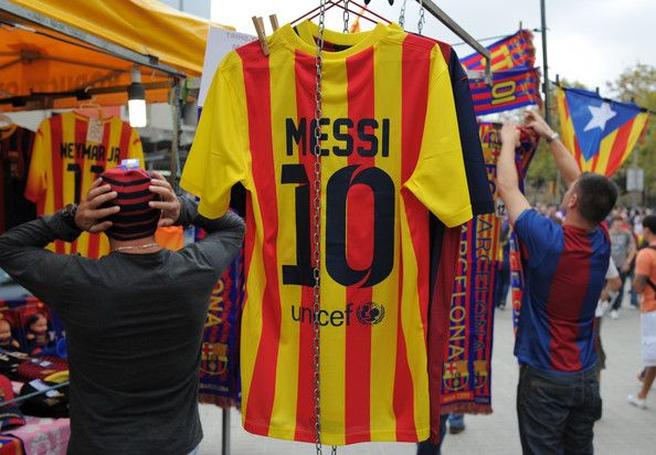 A Lionel Messi FC Barcelona shirt hangs from a merchandise shop before the La Liga match between FC Barcelona and Real Madrid CF at Camp Nou stadium on October 26, 2013 in Barcelona, Catalonia.