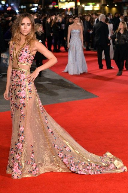 Suki Waterhouse wore a sheer, embroidered gown by Reem Acra.