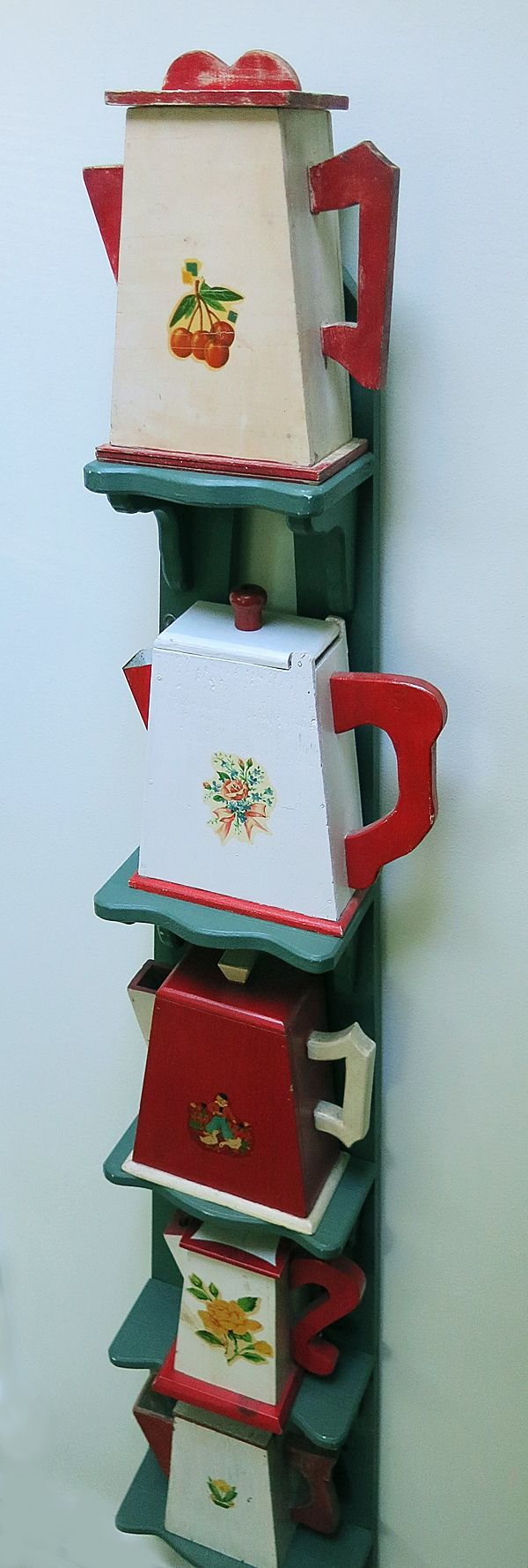The T-Cozy ~ these are vintage laundry detergent dispensers.  Very hard to find in good condition.  Great collection!
