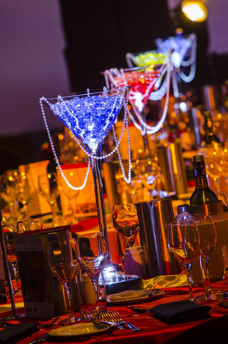 Simple yet effective table centrepieces add pops of colour to the table.