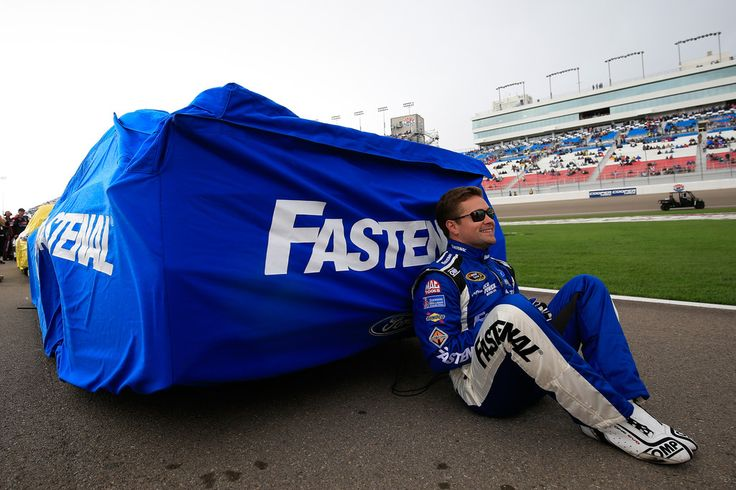 Ricky Stenhouse Jr Photos - Ricky Stenhouse Jr, driver of the #17 Fastenal Ford Fusion Ford, sits next to his covered car prior to the start of the NASCAR Sprint Cup Series Koblat 400 at Las Vegas Motor Speedway on March 6, 2016 in Las Vegas, Nevada. - NASCAR Sprint Cup Series Kobalt 400