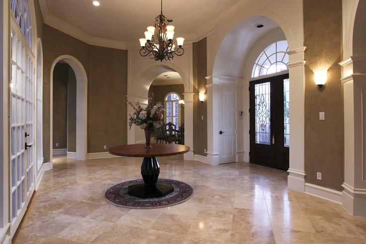 Perfect foyer; rotunda, travertine flooring, cased doorways