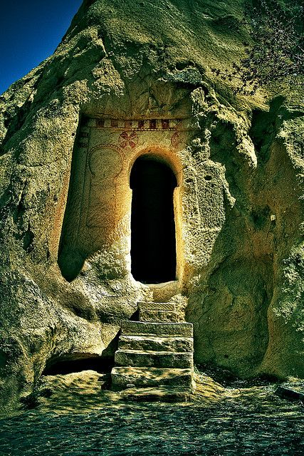 Doorway - Cappadocia, Turkey  I love how this door is key-shaped. It is bright and sunny outside, yet dark and mysterious inside. A welcome cool place out of the sun? Or a secret lair for mythical creatures? You've got my imagination stirred up now