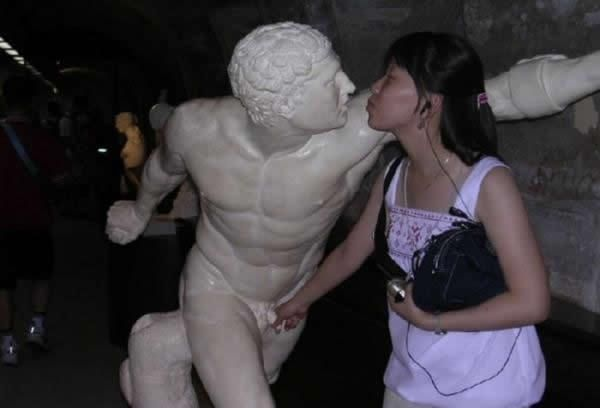 The Only Thing Shell Ever Get Hard In This Picture: Photo of girl groping statue
