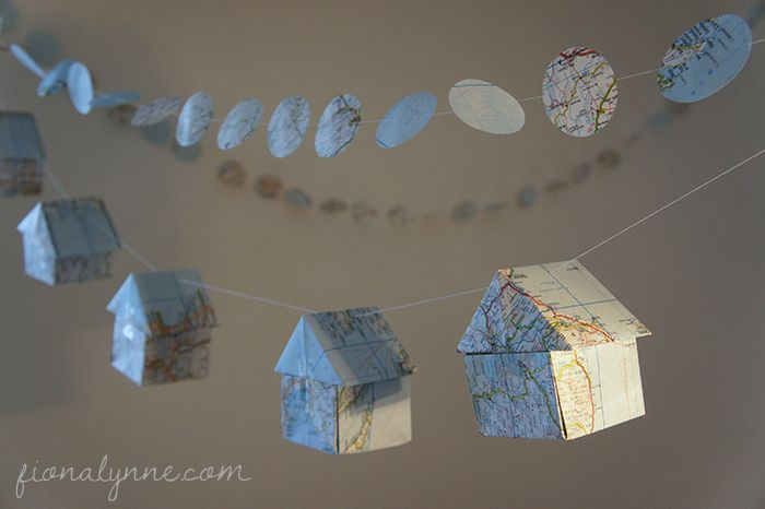 house warming party decorations - origami houses and garlands made from old maps!