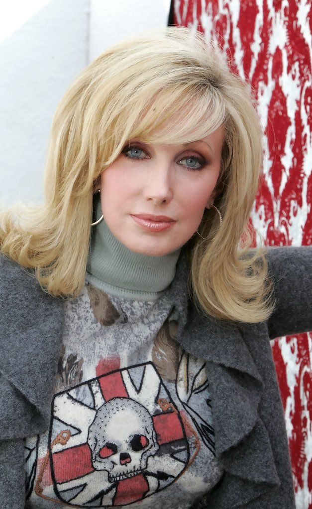 PICS VIA STYLEBISTRO Morgan Fairchild was retro-chic during Mercedes Benz Fashion Week with her flip hairstyle.
