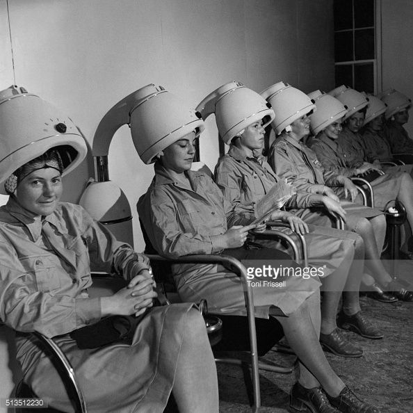 Vogue Magazine 1943. WAAC officers sitting under hair dryers at a beauty parlor. (Photo by Toni Frissell/Condé Nast via Getty Images)