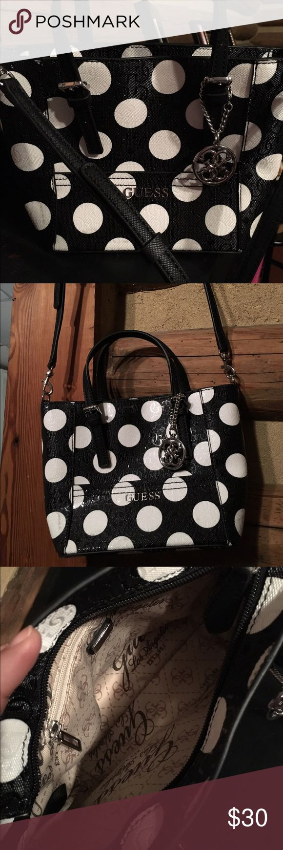👜 Polka dot Guess bag This is a very cute small Guess bag. Bought brand new, used once. Comes with long shoulder/crossbody straps. ⚫️⚪️ Guess Bags Totes