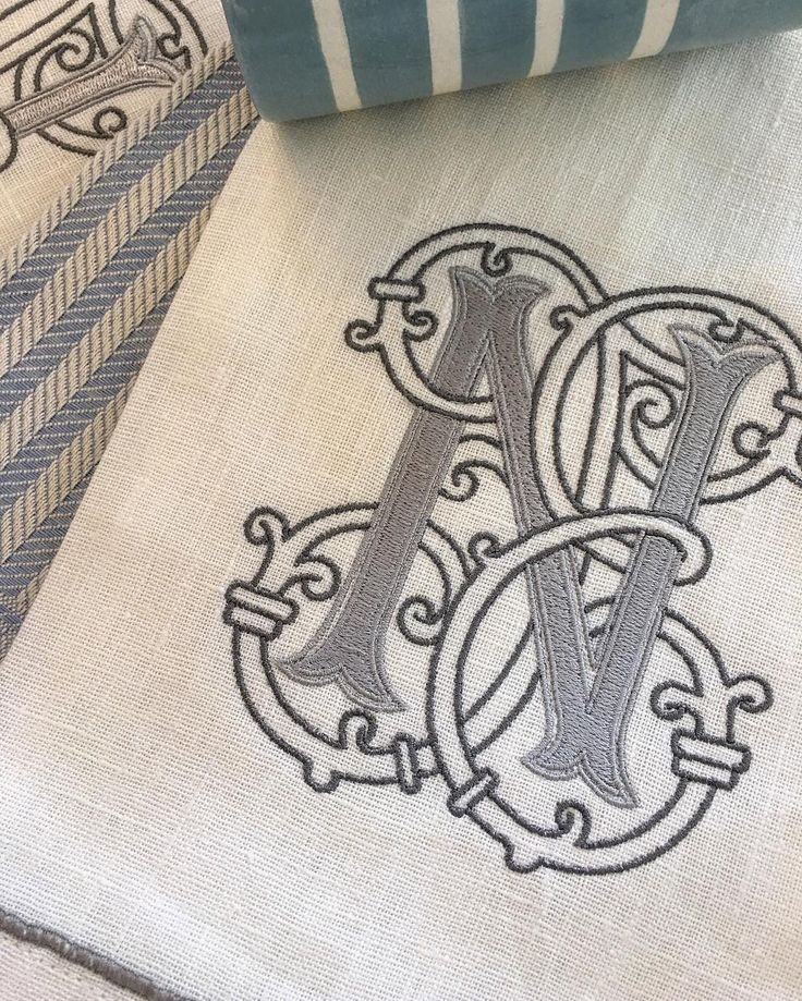 Silver tones on crispy starched linen hand towels. #numberfoureleven #vintagemonograms #monograms #linens #blueandwhite #silverandwhite #savannah #embroidery
