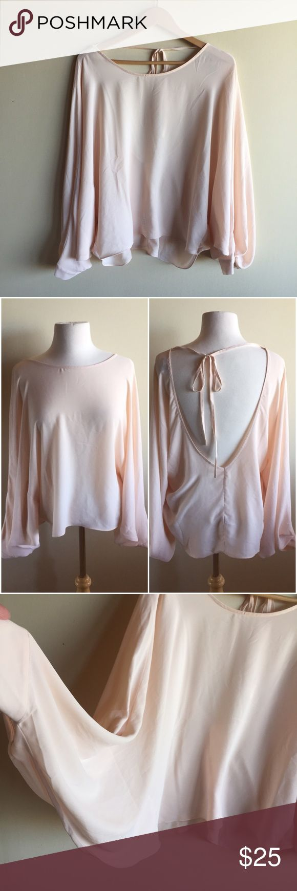 """ASOS blush pink batwing top with open back Gorgeous top in pale pink with an open back. Measures 27"""" long. Semi sheer. Great condition! ASOS Tops Blouses"""