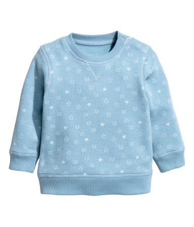 Blue/stars. CONSCIOUS. Soft, organic cotton sweatshirt with snap fasteners on one shoulder (sizes 9 - 24 months without snap fasteners) and ribbing at